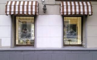 Металлический козырек над окном